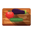 fresh eggplant0 tomato cucumber on a cutting board vector image