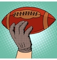ball american football in his hand vector image vector image