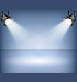 blue background with spotlights studio vector image vector image