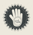 emblem with hand inside with handmade message vector image vector image