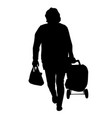 woman silhouette with bags on a white background vector image