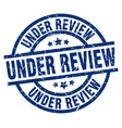 under review blue round grunge stamp vector image
