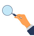 hand holding a magnifying glass vector image vector image