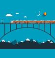 Train on bridge over mountains night