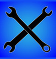 wrench silhouette isolated on blue background vector image