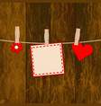 note on the wooden background with clothespins vector image vector image