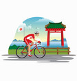 man cycling in japan with japanese gate as vector image vector image
