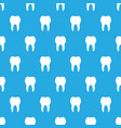 seamless pattern white teeth on blue background vector image
