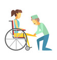 male doctor helping woman sitting on wheelchair vector image vector image