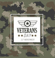 veterans day with emblem over military cloth vector image