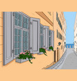 narrow city street with flowers in window boxes vector image vector image