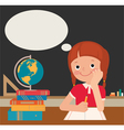 Schoolgirl sits at a school desk vector image