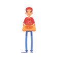 smiling delivery man stands in cap and t-shirt vector image vector image