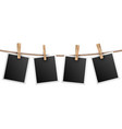 retro photo frames hanging on rope isolated on vector image vector image