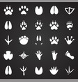 animal foot prints icons set on black background vector image