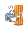 photographer air mattress mascot cartoon vector image