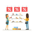 women choosing and buying shoes in store girl vector image