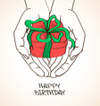 with human hands holding a gift vector image