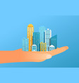 human hand holding modern city vector image vector image