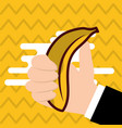 hand holding banana fresh colored background vector image