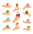 hands holding decorated cupcakes set vector image vector image