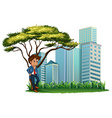 A man under the tree across the tall buildings vector image vector image