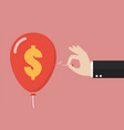 hand pushing needle to pop the dollar sign balloon vector image vector image