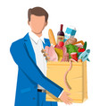 man with shopping bag full fresh products vector image vector image