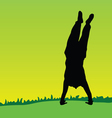 handstand on green grass black silhouette vector image vector image
