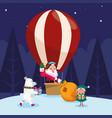 santa claus in a hot air balloon and polar bear