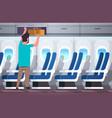 man passenger putting luggage on top shelf travel vector image