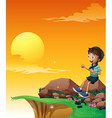 A happy boy sitting at the big rock near the cliff vector image vector image