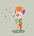 clown boy shooting a party popper confetti vector image vector image