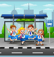 happy students at the bus stop vector image vector image