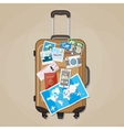 Tourist equipment on brown travel suitcase vector image