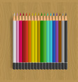 color pencils set on woodenbackground vector image
