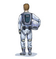male astronaut with helmet in hand back view vector image