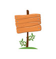 old wooden road sign standing on the grass vector image vector image