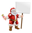 santa holding paintbrush and sign vector image