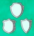 Set of woodcut shields vector image