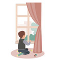 sad little boy sitting at window stay at home vector image