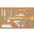 a set of carpenter s tools on a wooden table vector image