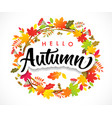 hello autumn calligraphy with wreath leaves vector image