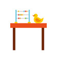 table with rubber duck toy icon vector image vector image