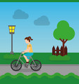 cheerful woman riding a bike on a park road vector image vector image