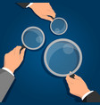 businessman hands holding magnifying glass vector image