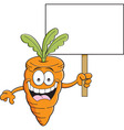 Cartoon carrot holding a sign vector image vector image