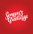 seasons greetings hand lettering on red vector image