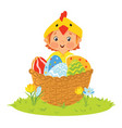 baby wearing chick costume in a basket with eggs vector image vector image
