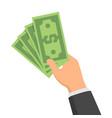 hand holding green money banknotes flat design vector image